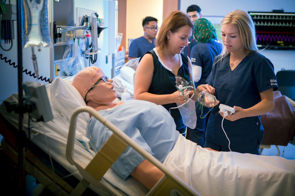 Nursing professor Judy Bornais teaches in the simulation suites in the medical education building.