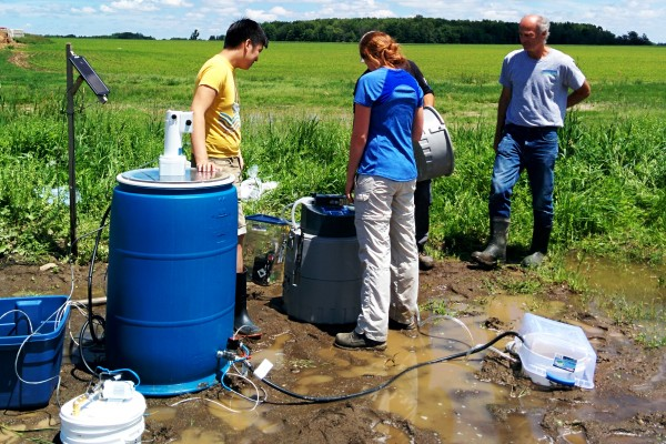 A group of graduate students from UWindsor researcher Bulent Mutus' lab working with the biofilter, a filter that can remove potentially harmful phosphates from contaminated water.