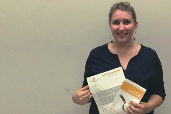 Chelsea Meloche displays her award letter