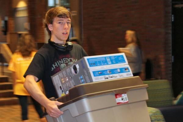 kid hauling boxes to dorm room