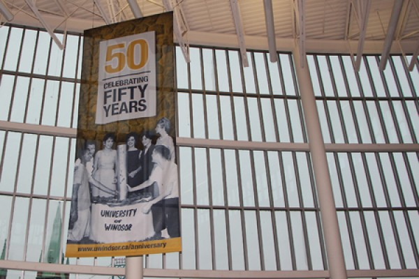 50th anniversary banner hanging in CAW Student Centre