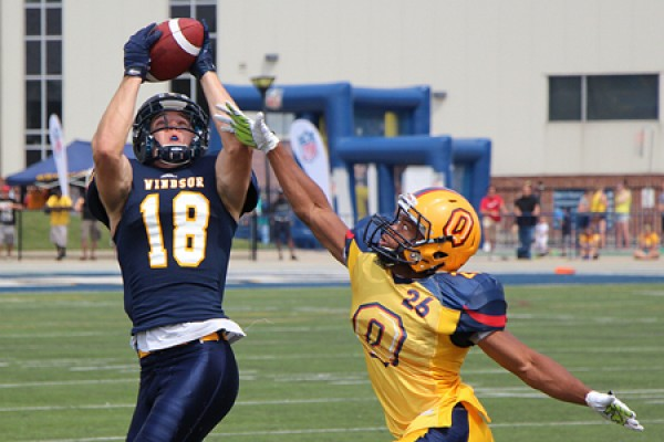 Lancer receiver Evan Pszczonak grabs a pass.