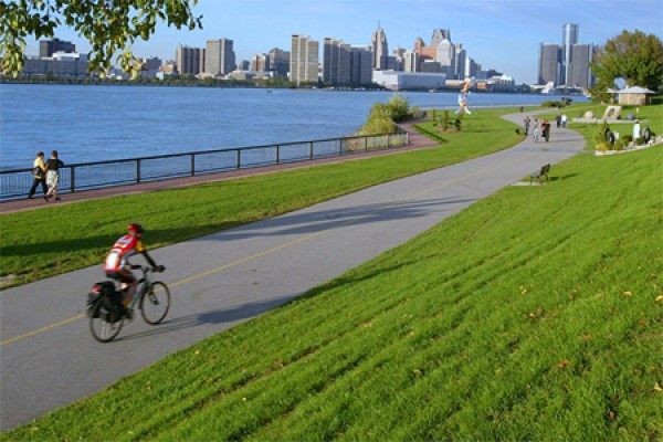 cyclist riding along riverfront trail