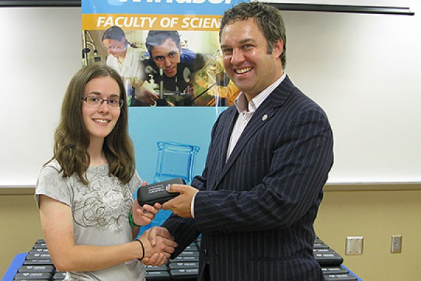 Brittany Ives shaking hands with Charles Macdonald