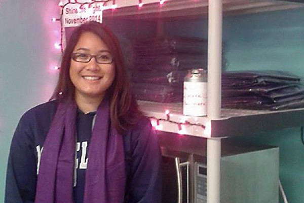 Tracy Huynh sports a purple scarf to symbolize the fight against domestic violence.