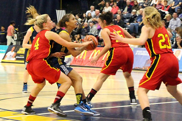 Guard Korissa Williams draws a crowd of Guelph defenders