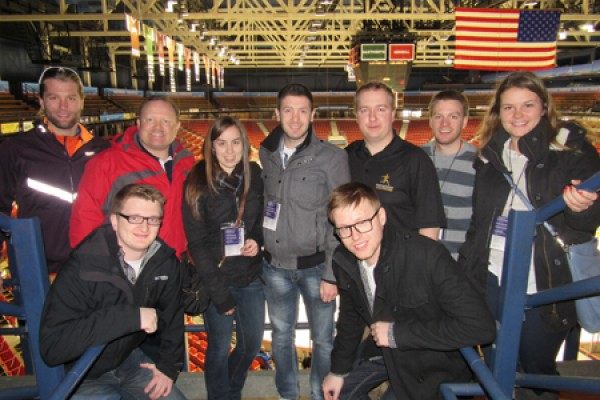 "Students pose with professor Scott Martyn in the Lake Placid arena that hosted the 1980 ""Miracle on Ice."""