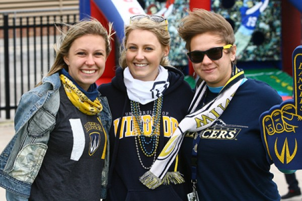 students pose in Lancer gear