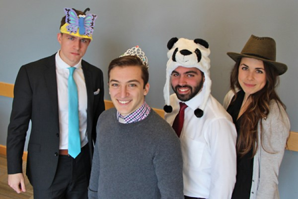 MBA students Connor Paterson, Michael Ruffolo, Tyler Jahn and Jessica O'Kane wearing silly hats.