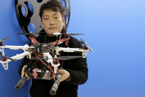 Min Bae holding drone
