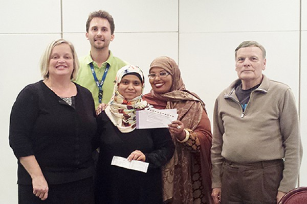 Sameena Sultana (centre) accepts congratulations from Patti Lauzon of the alumni office and OPUS officials Steve Jancev, Maryan Amalow and Edward King