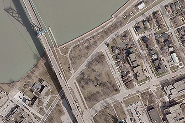 aerial image of UWindsor campus and Ambassador Bridge