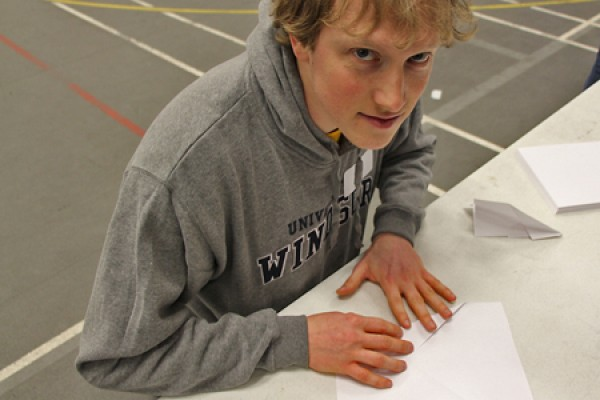 Paul Borger, a master's student in engineering, folds an airplane design in preparation for competition. His 24.82 m flight was good for second place.