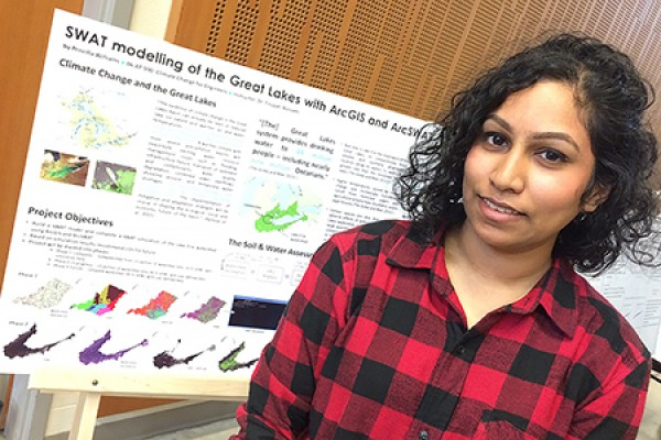 Priscilla Williams displays her research on climate change and the Great Lakes.