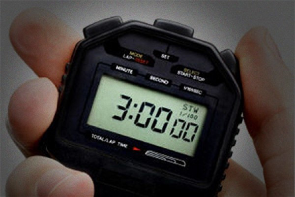 hand holding stopwatch set to 3 minutes