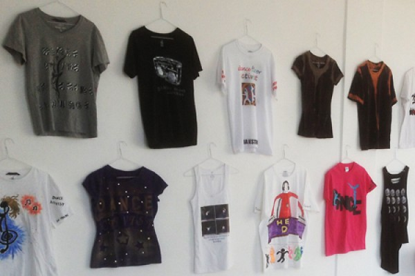 T-shirts on hangers against gallery wall