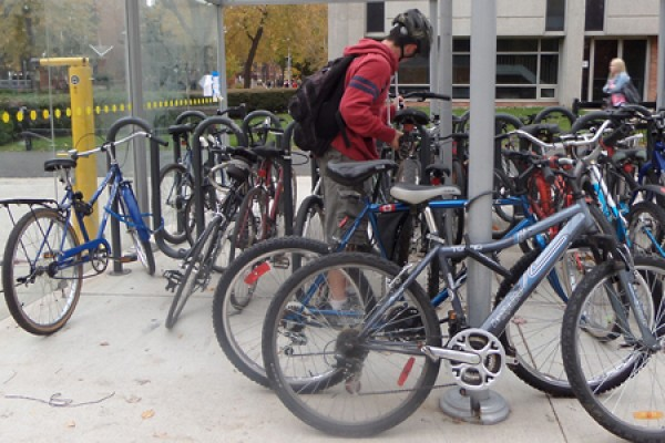 Hayden Burnett locks his bike in the shelter outside Essex Hall.