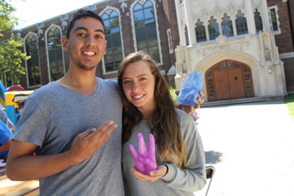 Ali Kareem and Katherine Lambruzzo show off wax casts of their hands