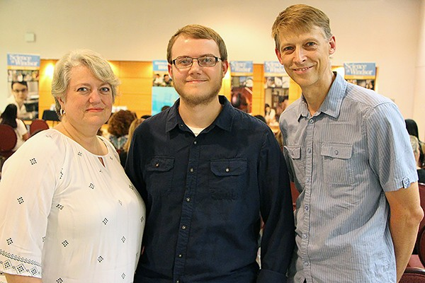 Mother Mary-Lyn and father James flank first-year computer science student Adam Vandolder.