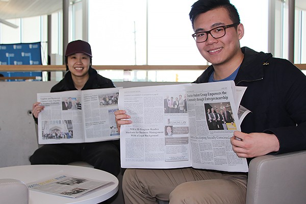 onnie Ton and Tony Meng show off the articles they contributed to the Odette Business Review.