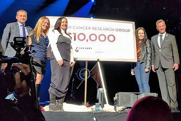 Representatives of the Windsor Cancer Research Group accept a $10,000 donation from Caesars Windsor during a cheque presentation Tuesday in the casino.