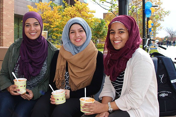 Afnane Kraba, Sarah Al-Zaher and Khadija Shamisa enjoy bowls of chili