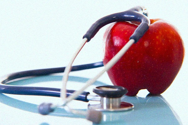 apple wrapped in stethoscope