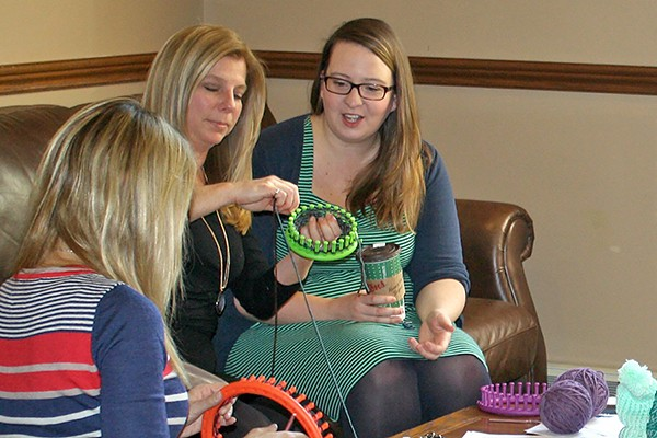 Loom knitters learn how it's done in Assumption Hall.