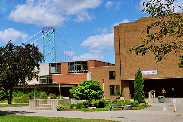 Leddy Library with Ambassador Bridge looming behind it