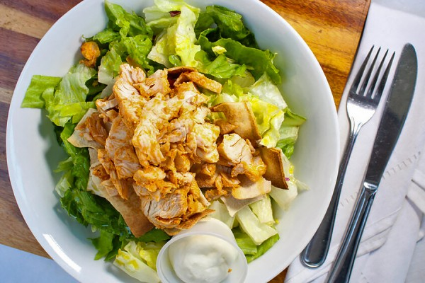 an Adam's salad: romaine layered with hummus and more