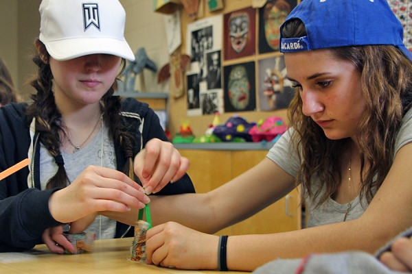 Alexis Pelletier and Kierra Marentette, Grade 8 students at Lakeshore Discovery School, work on their secret project during the Let's Talk Science Challenge, Friday in the Education Building.