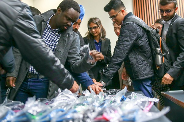 Students eagerly accept swag from BlackBerry.