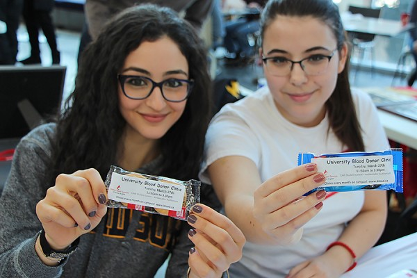 Desiree Mikhael and Milana Milivojevic display packets of cookies