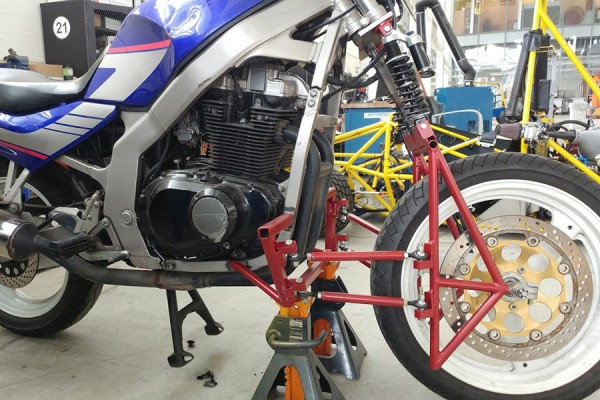 multilink design of front suspension for motorcycles