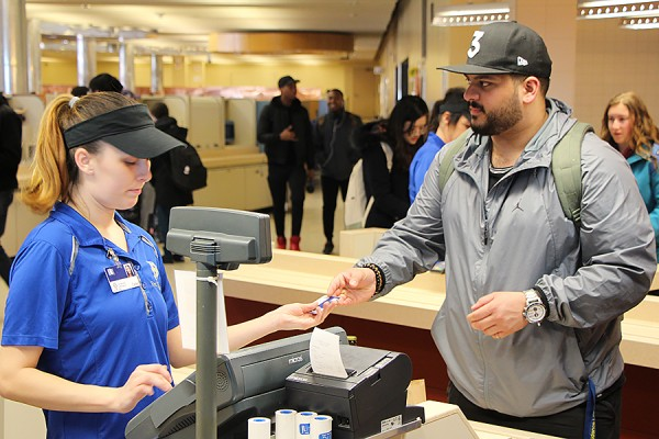 cashier serving student in Marketplace
