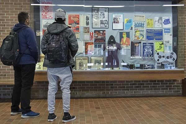 Students look at a display of CJAMfm memorabilia in the Leddy Library lobby.
