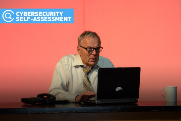 Person frantically working on computer to complete Cybersecurity Learning Modules and Self-Assessment