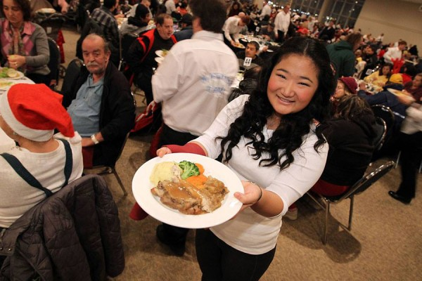 UWindsor student Eileen Chen serves a holiday meal at a dinner for Windsor's needy.