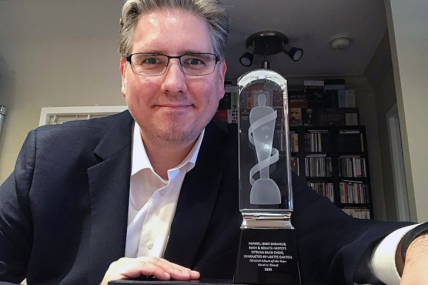 John Holland poses with his Juno statuette