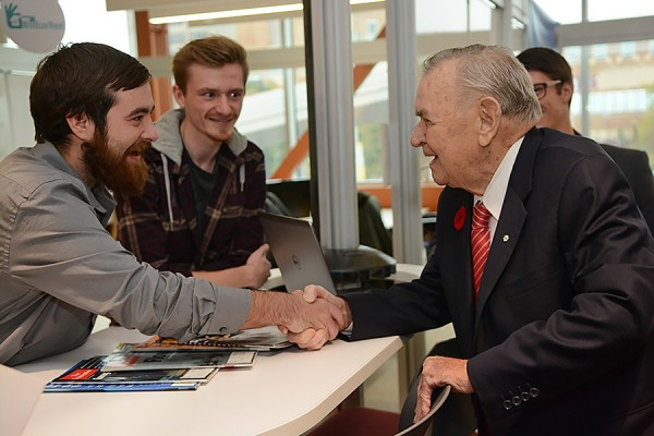 Ron Joyce (right) meets some students