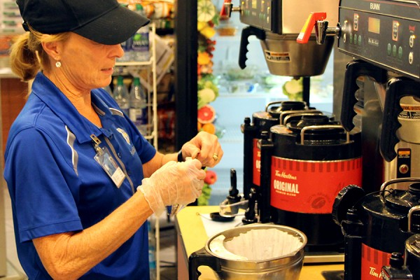 Food Services worker filling Tim Hortons percolator