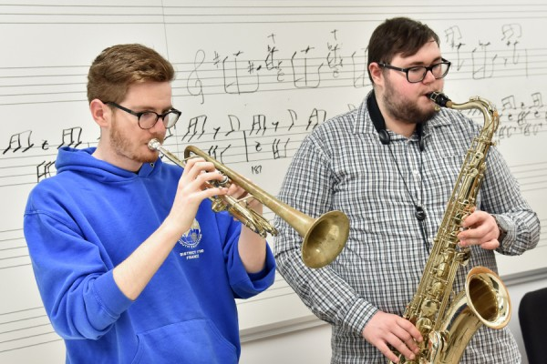 students playing trumpet and saxophone
