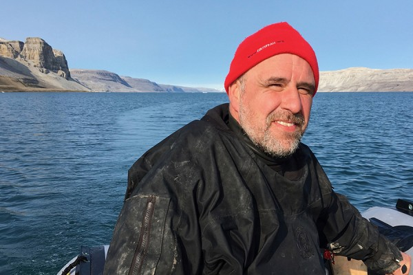 Nigel Hussey in boat in Arctic waters