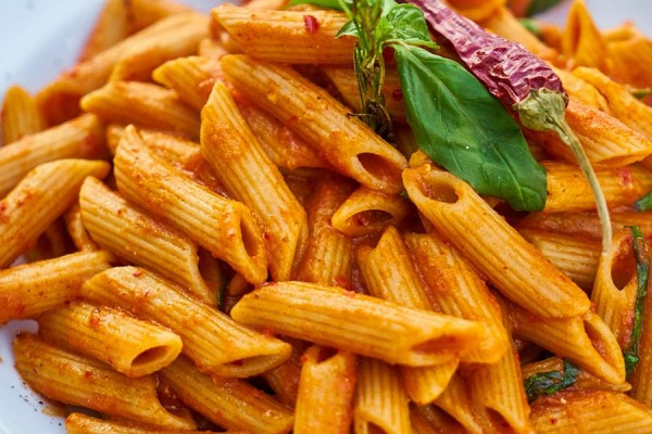 plate of penne with tomato sauce