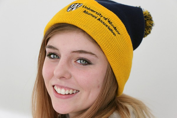 Drama student Paige Romberg models an alumni toque like the one offered in today's DailyNews quiz contest.