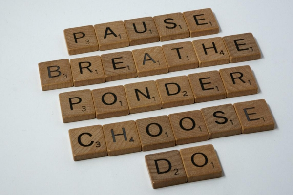 "scrabble tiles spelling ""pause"" and similar de-stressing terms"