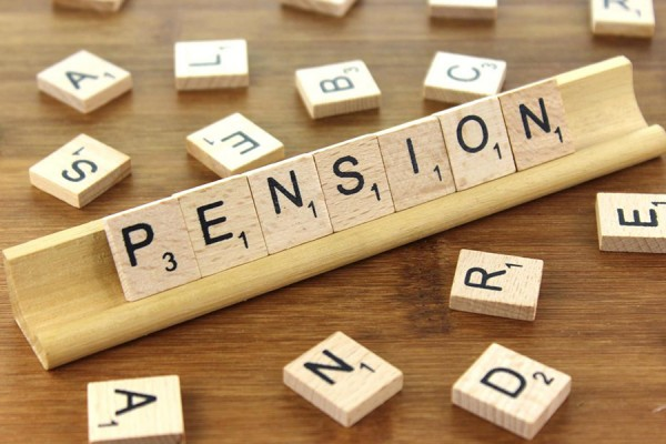 pension spelled out in Scrabble tiles