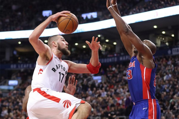 Raptor player scoring over Piston defender