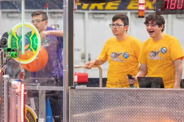 Members of Catholic Central High School's Electric Comets robotics team compete in the FIRST Robotics Competition at the St. Denis Centre on Friday, March 29.