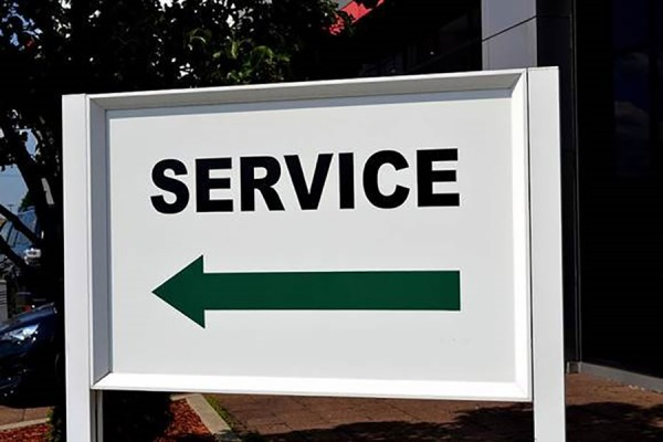 "Sign with arrow pointing in direction labelled ""Service"""
